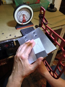 Using the rotational bench pin and magnetic protractor.